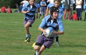 OBH pupils paying a competitive game of rugby in the vast school grounds