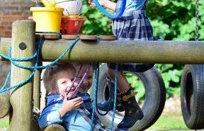 OBH prep-prep children having fun on the play equipment in the pre-prep walled garden