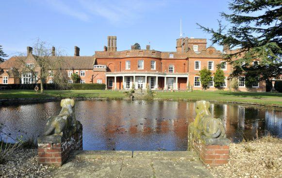Old Buckenham Hall School rear view across the mirror pond