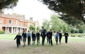 Headmaster David Griffiths with OBH pupils walking across the lawn