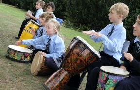 OBH samba band rehearsing in the school grounds