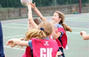 OBH girls playing a fast paced game of netball