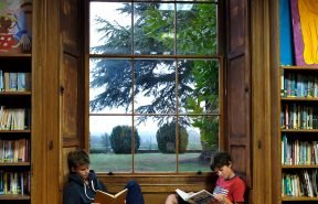Two OBH pupils having some quiet time in the library reading books