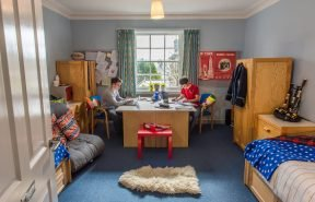 Two boarders studying in McNabb and Tait, Dollar Academy's Boys Boarding House