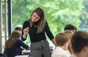 Teacher assisting pupils in Dollar Academy's Westwater Building
