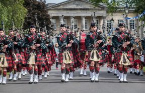 Dollar Academy's award winning Pipe Band performing in front of Playfair Building