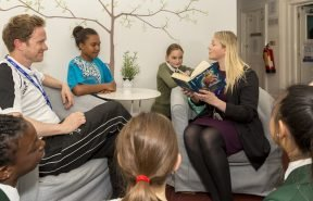 House Parent Gemma Aukett reads a book before bedtime to girls in her Boarding House.